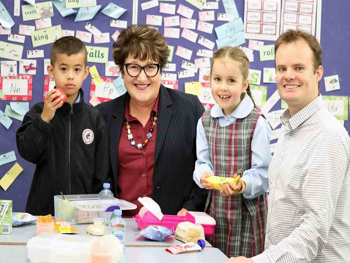 Investigating some healthy lunch choices at the launch are Oliver, nib foundation director Michelle McPherson, Ella and Associate Professor Luke Wolfenden.